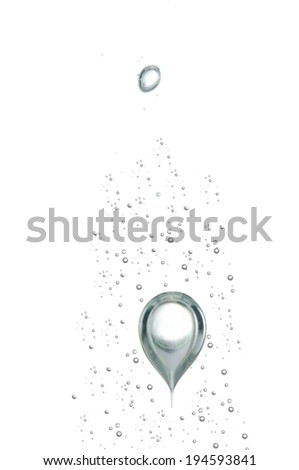 hundred of small air bubbles emerge toward the surface - stock photo