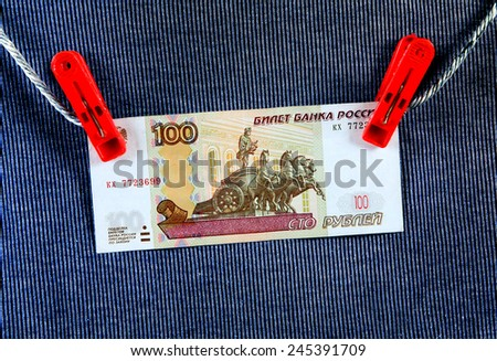 Hundred Russian Rubles on the Rope and the Textile Background - stock photo