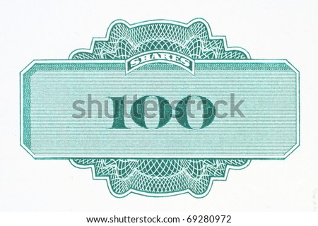 Hundred shares - close up of a vintage stock market object. Obsolete corporate shares certificate. - stock photo