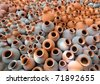 Hundreds of earthen water jars used in rural areas are stacked together - stock photo