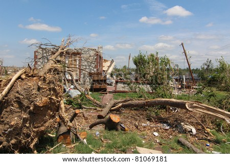 Hundreds of mature trees torn out of the ground only added to the already extensive damage caused by EF-5 tornadoes in the Midwest and the South as they fell onto homes they had once shaded. - stock photo
