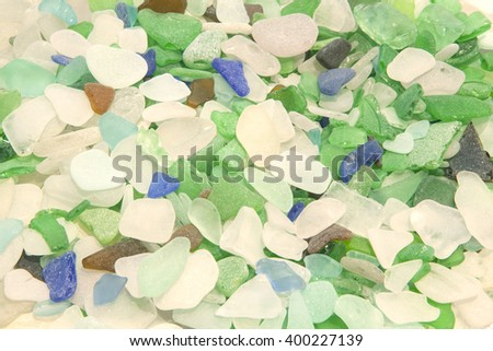 Hundreds of pieces of Lake Michigan beach glass, or sea glass, in various colors such as aqua, blue, green, brown and shades of whites in a soothing composition with no intended focal point. - stock photo