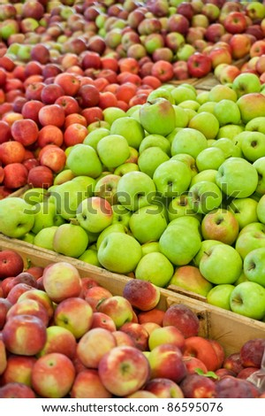 Hundreds of red, yellow and green apples in bins at a Michigan farm market in autumn. - stock photo