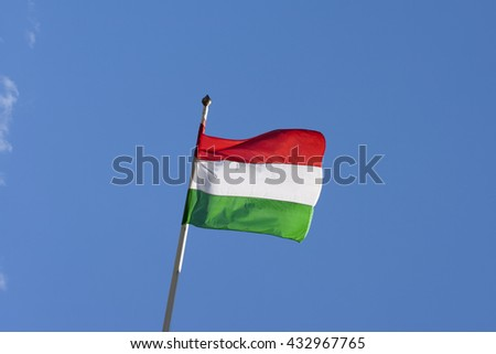 Hungarian flag against the blue sky - stock photo