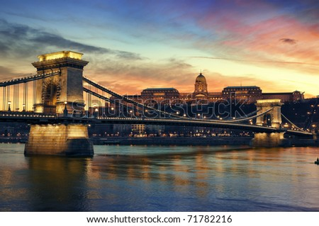 Hungarian landmarks, Chain Bridge, Royal Palace and Danube river in Budapest at sunset. - stock photo