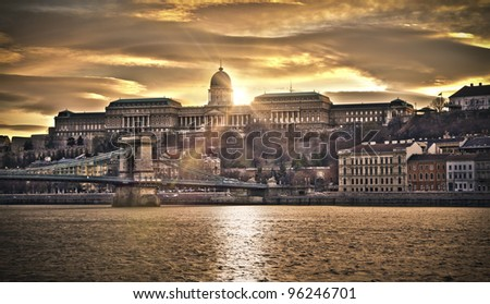 Hungarian landmarks, Chain Bridge, Royal Palace and Danube river in Budapest at sunset. HDR image. - stock photo