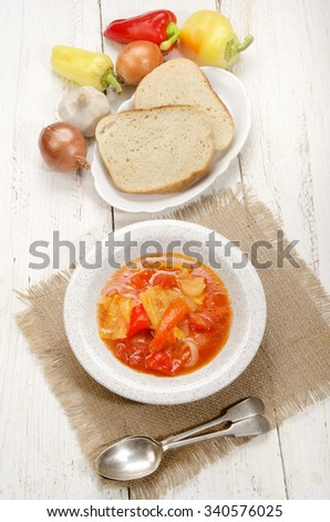 hungarian letscho with sweet peppers on a plate - stock photo