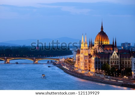 Hungarian Parliament Building and Danube river at evening in Budapest, Hungary. - stock photo