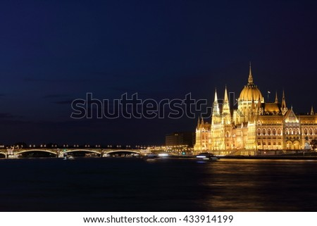 Hungarian Parliament Building and Margaret Bridge on the Pest bank of Danube River, Budapest, Hungary - stock photo