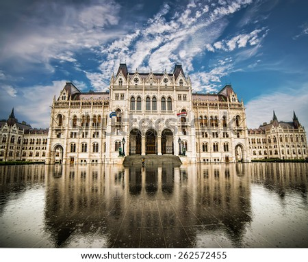 Hungarian Parliament building with reflection against blue sky in Budapest, Hungary - stock photo