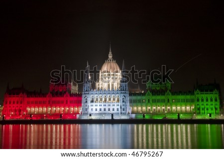 Hungarian parliament in national colours - stock photo