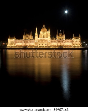 Hungarian parliament with Moon and floodlight at night, Budapest - stock photo