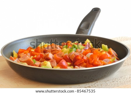 hungarian stew in the pan on a wooden board with a white background - stock photo