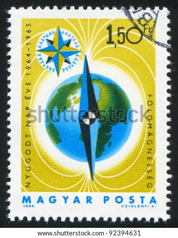 HUNGARY - CIRCA 1965: A stamp printed by Hungary, shows Earth, circa 1965 - stock photo