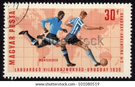 HUNGARY - CIRCA 1966: a stamp printed by Hungary shows football players.World football cup in Montevideo 1930, series, circa 1966 - stock photo