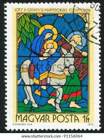 HUNGARY - CIRCA 1972: A stamp printed by Hungary, shows Stained-glass Window, Flight into Egypt, by Karoly Lotz and Bertalan Szekely, circa 1972 - stock photo