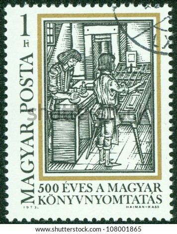 "HUNGARY - CIRCA 1973: A stamp printed by Hungary, shows Typesetting, from ""Orbis Pictus,"" by Comenius, circa 1973"