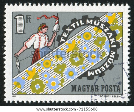 HUNGARY - CIRCA 1972: A stamp printed by Hungary, shows Weaver, Cloth and Cogwheel, circa 1972