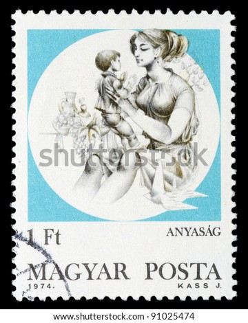 HUNGARY - CIRCA 1974: A stamp printed by Hungary, shows woman with a child on hands, circa 1974 - stock photo