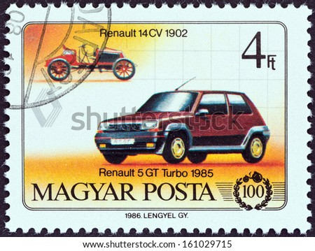 "HUNGARY - CIRCA 1986: A stamp printed in Hungary from the ""Centenary of Motor Car "" issue shows Renault 14 CV, 1902, and Renault 5 GT Turbo, 1985, circa 1986."