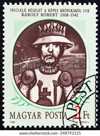 """HUNGARY - CIRCA 1988: A stamp printed in Hungary from the """"Hungarian Kings """" 2nd issue shows Karoly I (Charles Robert), detail of decorated initial from Illuminated Chronicle, 1358, circa 1988.  - stock photo"""