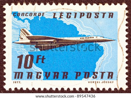 "HUNGARY - CIRCA 1977: A stamp printed in Hungary from the ""Planes, Airlines and Maps"" issue shows an Aerospatiale-BAC Concorde, Air France and South America map, circa 1977. - stock photo"