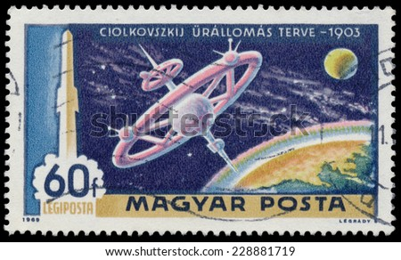 """HUNGARY - CIRCA 1969: A stamp printed in Hungary from the """"1st Man on the Moon"""" 2nd issue shows Tsiolkovsky's space station, circa 1969.  - stock photo"""
