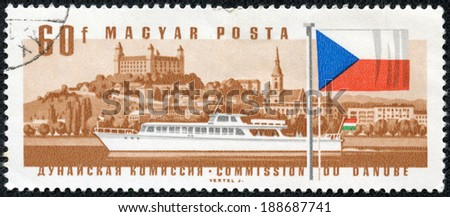 "HUNGARY - CIRCA 1967: A stamp printed in Hungary from the ""25th Session of Danube Commission"" issue shows hydro bus Revfulop and Bratislava Castle, Slovakia, circa 1967. - stock photo"