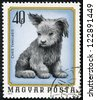 """HUNGARY - CIRCA 1974: A stamp printed in Hungary from the """"Young animals"""" issue shows a dog puppy, circa 1974. - stock photo"""