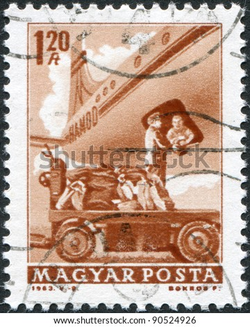 HUNGARY - CIRCA 1963: A stamp printed in Hungary, is depicted in loading mail plane, circa 1963 - stock photo