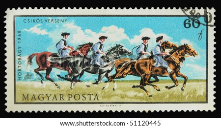 HUNGARY - CIRCA 1968: A stamp printed in Hungary showing horse riders circa 1968
