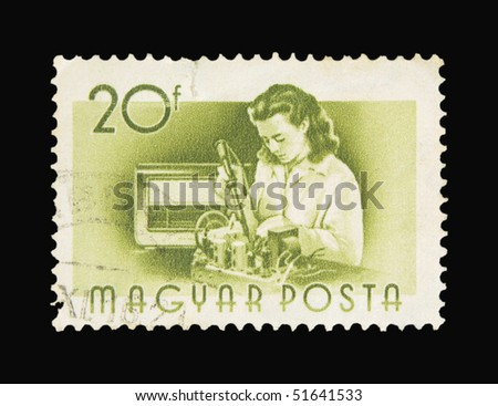 HUNGARY - CIRCA 1955: A stamp printed in Hungary showing woman repairing a device, circa 1955