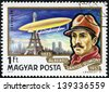 HUNGARY - CIRCA 1977: A Stamp printed in HUNGARY shows a Brazilian aviation pioneer Alberto Santos-Dumont and his dirigible over Eiffel Tower in Paris, circa 1977 - stock photo