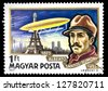 "HUNGARY - CIRCA 1977: A stamp printed in Hungary, shows airship over Paris Air and portrait of Alberto Santos-Dumont, with the same inscription, from the series ""History of Airships"", circa 1977 - stock photo"