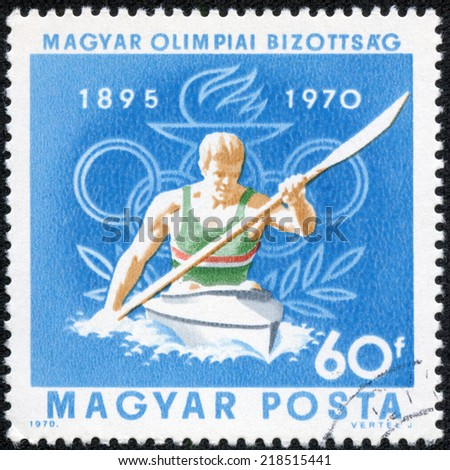 """HUNGARY - CIRCA 1970: A stamp printed in Hungary, shows Canoeing and Olympic Rings, with inscription and name of series """"75th Anniversary of Hungarian Olympic Committee, 1895 - 1970"""", circa 1970 - stock photo"""