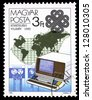 """HUNGARY - CIRCA 1983: A Stamp printed in Hungary shows Computer terminal, with inscription and name of series """"World Communications Year"""", circa 1983 - stock photo"""