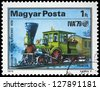 "HUNGARY - CIRCA 1979: A stamp printed in Hungary shows emblem of International Transport Exhibition and Locomotive ""Pioneer"", 1836, with the same inscription, series ""Railroad Development"", circa 1979 - stock photo"