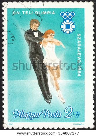 """HUNGARY - CIRCA 1983: A stamp printed in Hungary, shows Ice Dancing and Olympic emblem, with inscription and name of the series """" XIV Winter Olympic Games in Sarajevo. 1984"""", circa 1983  - stock photo"""