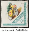HUNGARY - CIRCA 1962: a stamp printed in Hungary shows illustration of a motoracer. Hungary, circa 1962 - stock photo