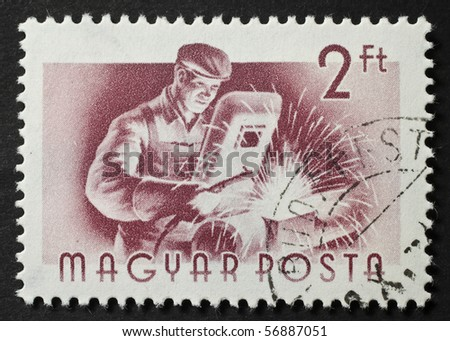 HUNGARY - CIRCA 1955: a stamp printed in Hungary shows image of a welder welding. Hungary, circa 1955 - stock photo