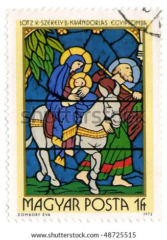 HUNGARY- CIRCA 1972: A stamp printed in Hungary shows image of the religious subjects, made at the stained-glass window, circa 1972. - stock photo