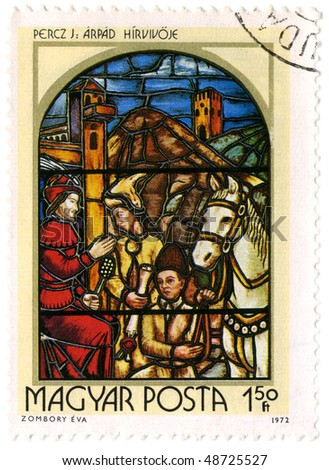 HUNGARY- CIRCA 1972: A stamp printed in Hungary shows image of the religious subjects made at the stained-glass window, circa 1972. - stock photo