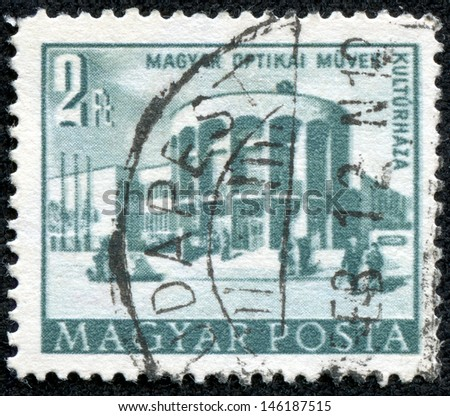 HUNGARY - CIRCA 1953: A stamp printed in Hungary shows Optical works house of culture, circa 1953