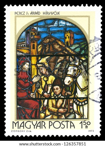 "HUNGARY - CIRCA 1972: A stamp printed in Hungary shows painting Prince Arpad's Messenger by Jeno Percz, with the same inscription, series ""Stained-glass Window"", circa 1972"