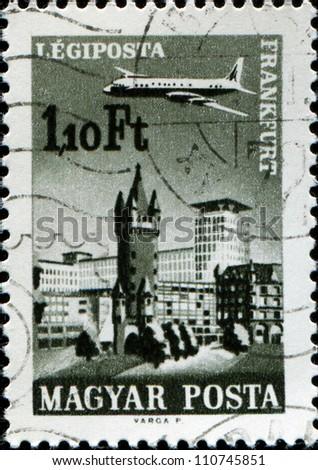 HUNGARY - CIRCA 1966: A stamp printed in Hungary shows plane abowe Frankfurt am Main, aircraft, Eschenheimer Turm and Eschenheimer Gate, circa 1966 - stock photo