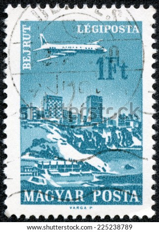 "HUNGARY - CIRCA 1966 : A stamp printed in Hungary shows Plane over Beirut, with the inscription ""Beirut"", from the series ""Plane over Cities served by Hungarian Airways"", circa 1966"