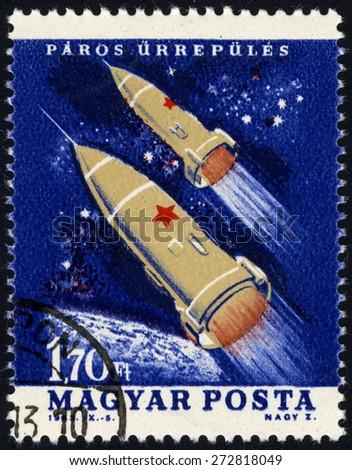 HUNGARY - CIRCA 1963: A stamp printed in Hungary shows Spacecraft Vostok III & IV, series U.S. & USSR Spacecraft, circa 1963 - stock photo