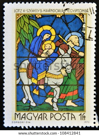 HUNGARY - CIRCA 1972: A stamp printed in Hungary shows Stained-glass Window, Flight into Egypt, circa 1972 - stock photo