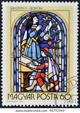 HUNGARY - CIRCA 1972: A stamp printed in Hungary, shows Stained-glass Window, 16th century scribe, by Ferenc Sebesteny, circa 1972 - stock photo