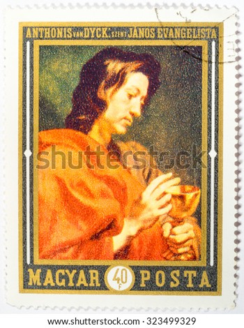 HUNGARY - CIRCA 1969: a stamp printed in Hungary shows the picture of St. Johannes Evangelist, by Anthony van Dyck, the famous flemish baroque artist. Hungary, circa 1969 - stock photo